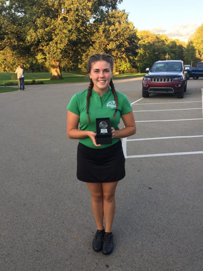 Senior+Joey+Walz+highlighted+the+women%E2%80%99s+golf+team+last+weekend+and+posed+with+her+award+after+winning+at+the+Grove+City+Invitational+on+Sept.+14.
