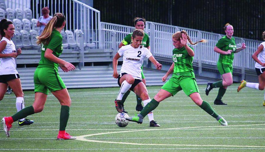 Nikki Polens, now a senior, attacks the ball in a game versus Lourdes University last season.