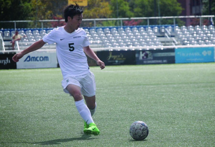 Yuki Takeda, now a senior, prepares to pass the ball to a teammate during a home game against Siena Heights during the 2017 season.