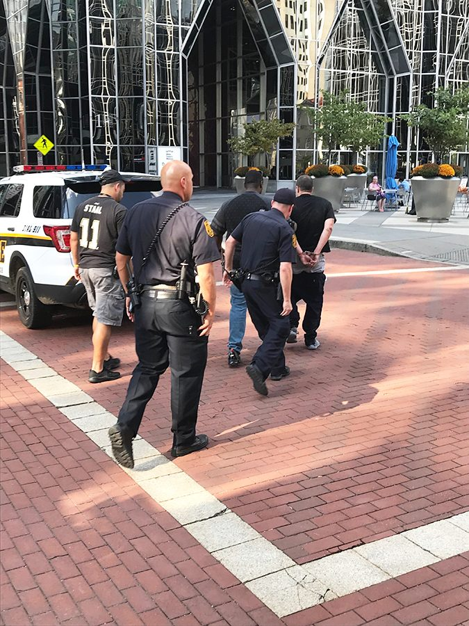 Pittsburgh police took the assaulter to the squad car at 3:22 p.m.