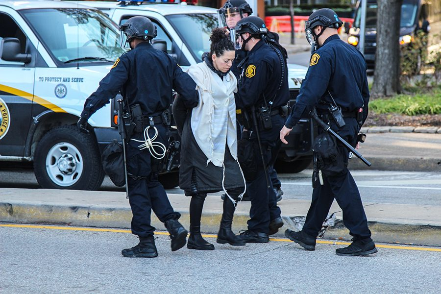 A+woman+is+arrested+during+city-wide+protests+that+occurred+in+response+to+President+Trump%E2%80%99s+visit+to+Pittsburgh+last+Wednesday%2C+October+23.