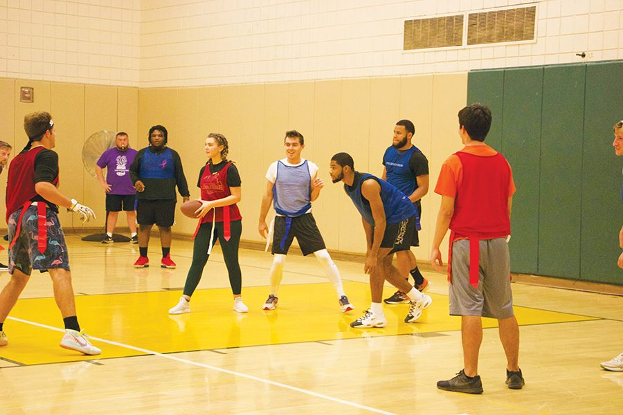 Students+participate+in+CAB%E2%80%99s+flag+football+game+last+Wednesday+in+the+Student+Center+Gym.