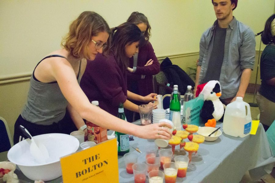 Junior Public Relations and Advertising major Emily MacIntyre and other Pioneer Ambassadors pour mocktails at SAIL's Mocktail Mixoff in Lawrence Hall Lobby on Wednesday, Nov. 13.