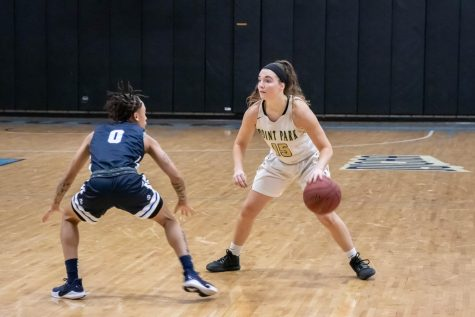 Junior guard Michelle Burns faces a defender from Bryant & Stratton on Saturday night. The Pioneers lost 76-75.