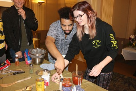Owen Lewis, left, and Stella Dickinson, right, partook in a cooking competition put on by ADFED and PRSSA on November 19 in the Lawrence Hall Ballroom. They were tasked with preparing a meal using only ingredients from the Pioneer Pantry.