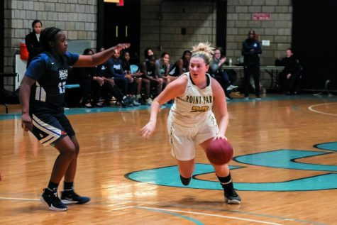 Freshman guard Sierra Seneta dribbles around a defender at CCAC-Allegheny.