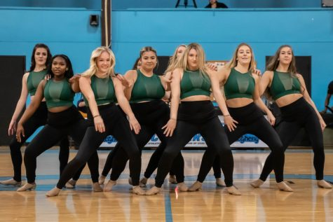 The dance team previews their competitive routine at halftime of a basketball game at CCAC-Allegheny.