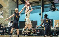 Men's basketball splits RSC games, clinch playoff spot