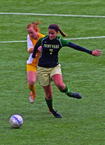 Women's soccer wins first KIAC title on late penalty kick