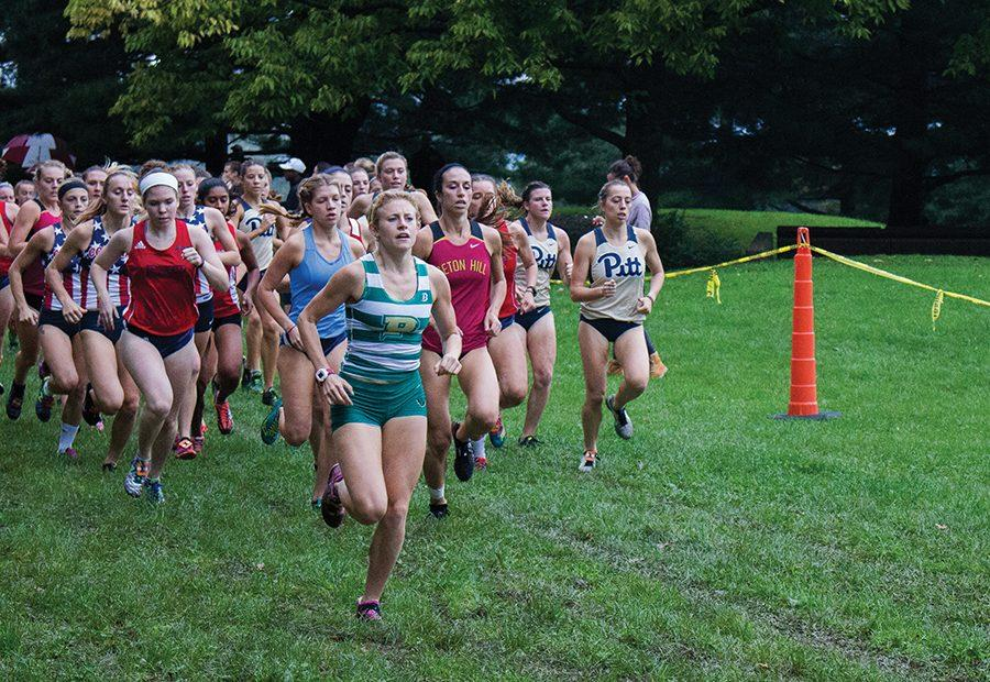 Junior Katie Guarnaccia leads the pack at the start of the CMU Invitational on October 8 at Schenley Park.