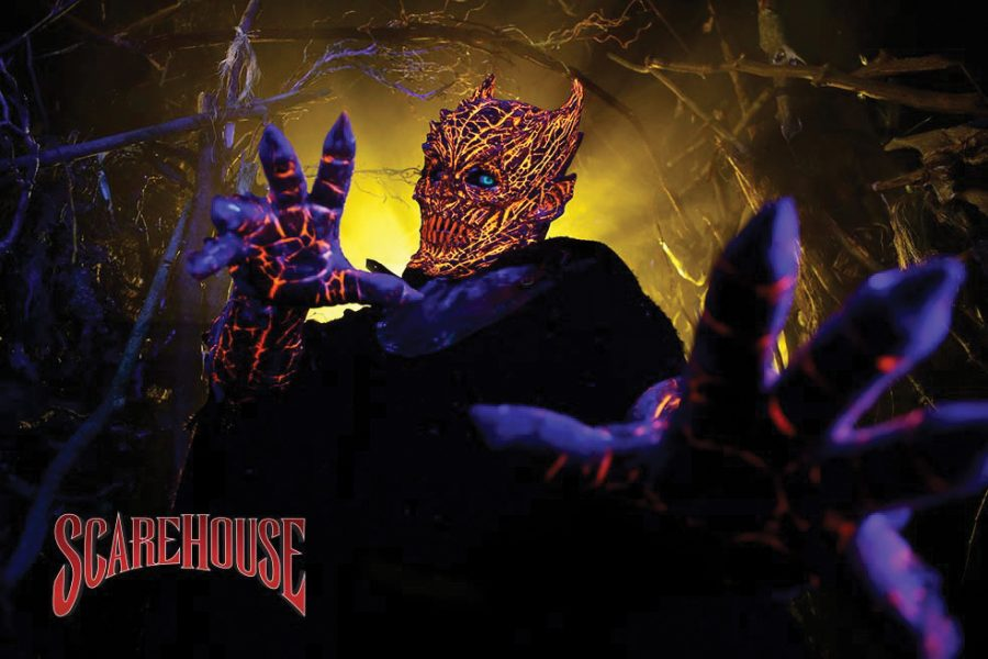 A monster lurching at the ScareHouse. Characters are created by the design team who give actors information about a character along with a backstory, to help them get into a scaring mindset.