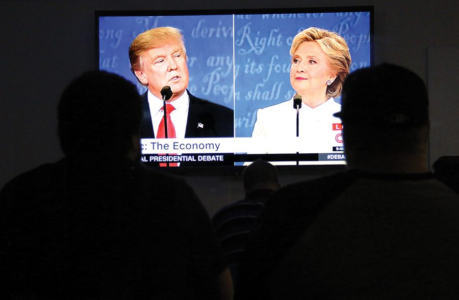 Students+watch+Donald+Trump+and+Hillary+Clinton+debate+for+the+final+time+on+the+screens+at+Point+Park+University%E2%80%99s+Center+for+Media+Innovation+on+Wednesday%2C+Oct.+17.