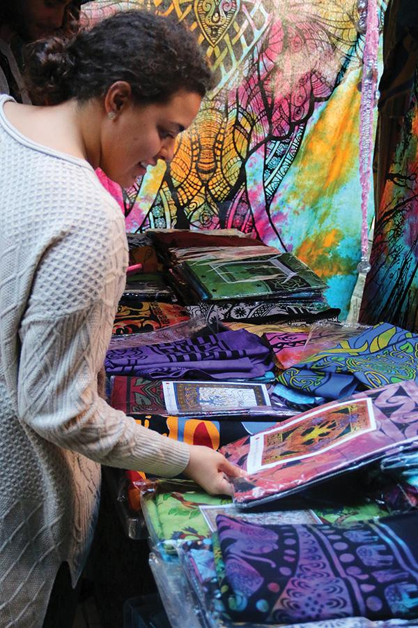 Gabby De Lima, senior business major, browses the selection of tapestries for sale in Village Park on Wednesday, October 12.