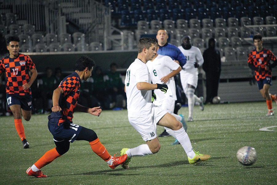 Freshman midfielder, Nathanael Van Der Walt, gains possession of the ball with a Washington Adventist defenceman on his heels during their match on October 26. The Pioneers won, 3-0.