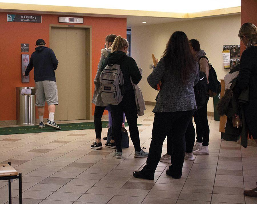 A line of students wait for an elevator in the West Penn Building before classes Dec. 5.