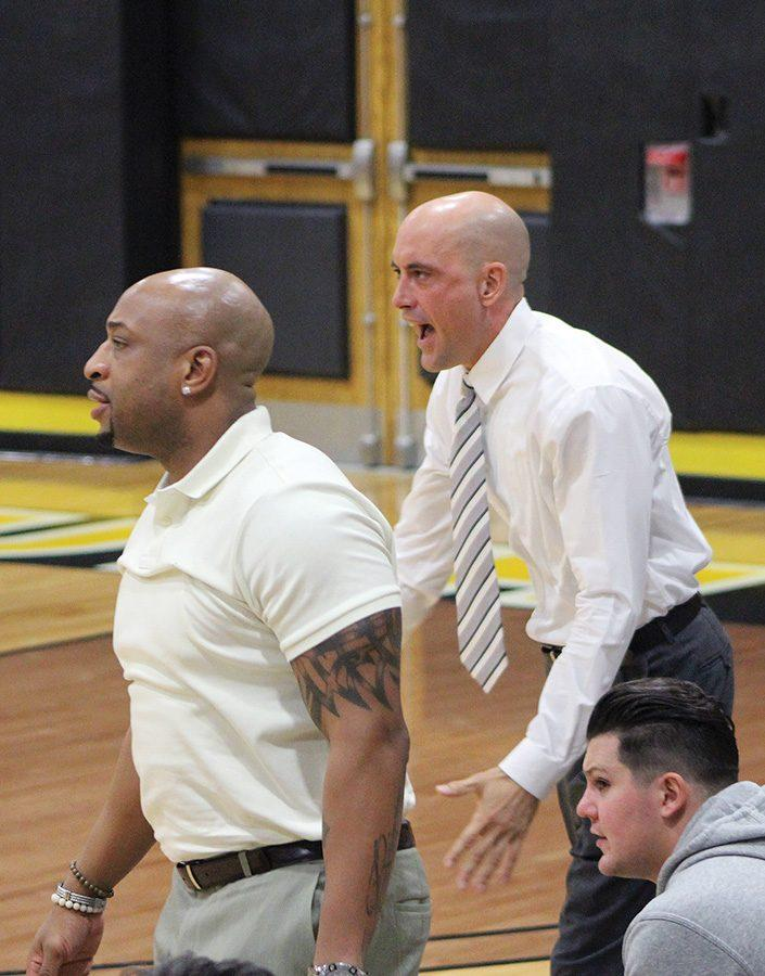Assistant head coach, Wayne Copeland, and interim head coach, Gabe Bubon, a 2000 graduate from Point Park, shout plays to their team on Dec. 3.