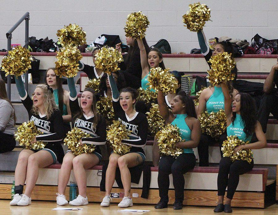 The 2015-16 competitive cheer and dance squad cheers on the Point Park basketball teams.