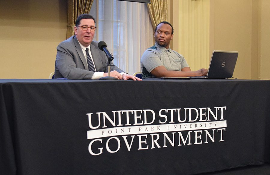 Recording Secretary, Davion Heron, listens to what Mayor Bill Peduto has to say during a special Q&A meeting on Monday.