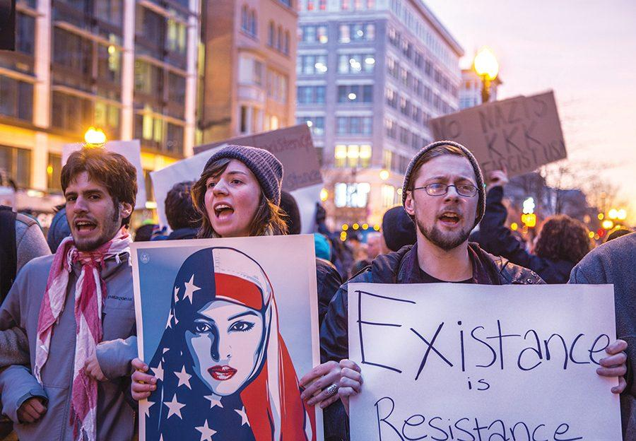 Protestors gather the morning of Inauguration Day and peacefully fight against the Trump agenda, using the hashtag #InauguratetheResistance under the organization ANSWER Coalition.