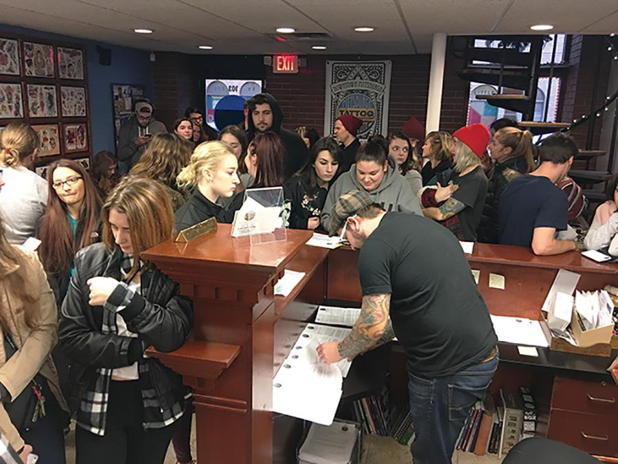 """Students from Point Park, Duquesne and Pitt flood Pittsburgh Tattoo Company as they hold their annual Friday the 13th tattoo special. The special included $13 pre-drawn tattoos with a required $7 tip. Incoming customers was cut off around 4:30 p.m. by tattoo artist Susie Humphrey, who called it the """"most successful special event they've had."""""""