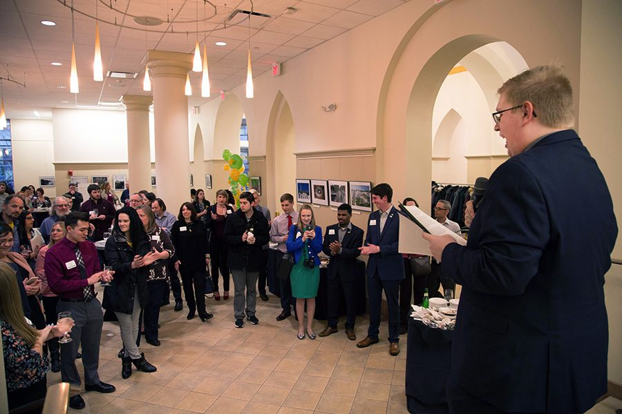 Alexander Popichak, Editor-in-Chief of The Globe, addresses five decades of Globe staff members. Over 100 current Globe staff members, faculty and alumni attended the 50th anniversary reunion event Saturday evening in the Lawrence Hall lobby.