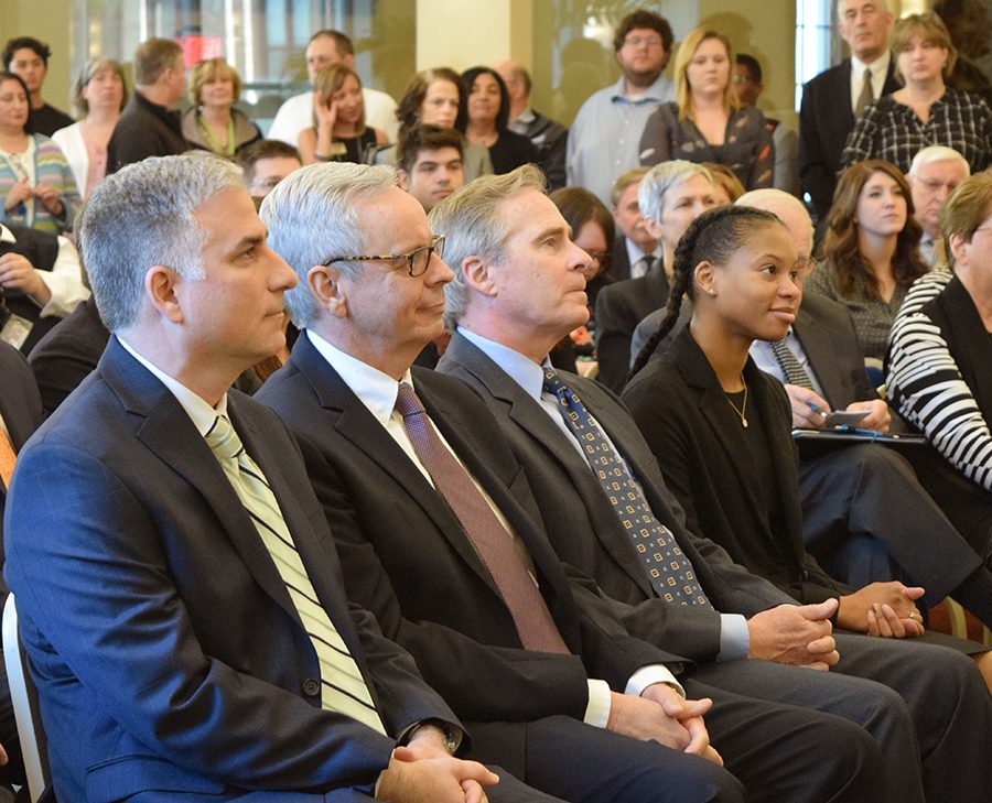 Newly appointed Rowland School of Business Dean, Steve Tanzilli, Provost John Pearson, President Paul Hennigan, and USG Treasurer, Amber Mole, listen to a presentation on Tuesday.