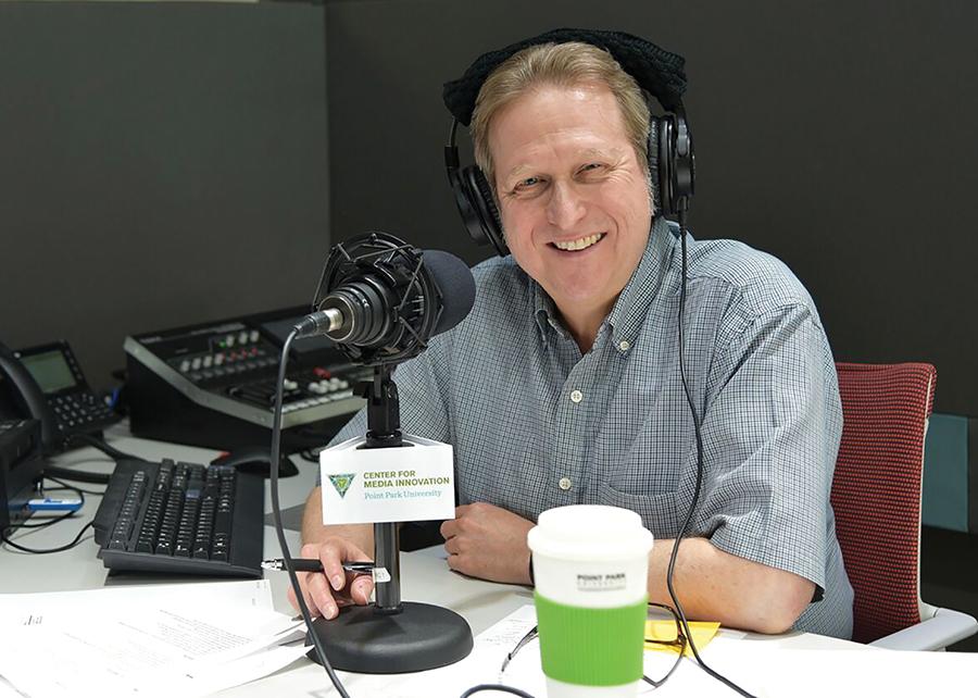 Steve+Cuden+records+his+new+podcast%2C+%E2%80%9CStoryBeat%E2%80%9D+in+the+Center+for+Media+Innovation+podcast+studio.