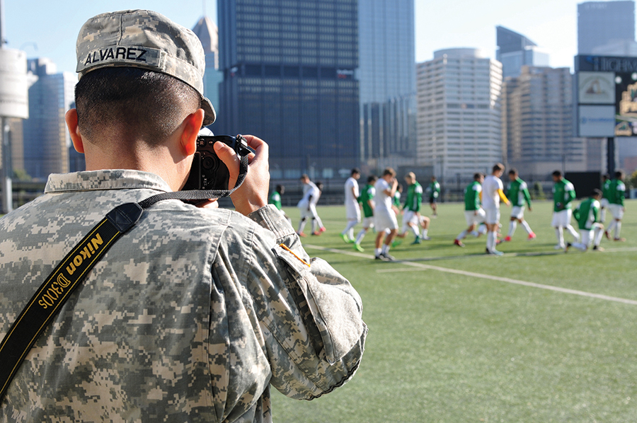 Spc. Miguel Alvarez, assigned to 354th MPAD, Coraopolis, Pennsylvania, photographs the Point Park University's men's soccer team during a training exercise September 5, 2017. The 354 MPAD used the Point Park University's military appreciation game as an opportunity to conduct soldier training for photography and videography. (Army photo by Staff Sgt. Debra Richardson)