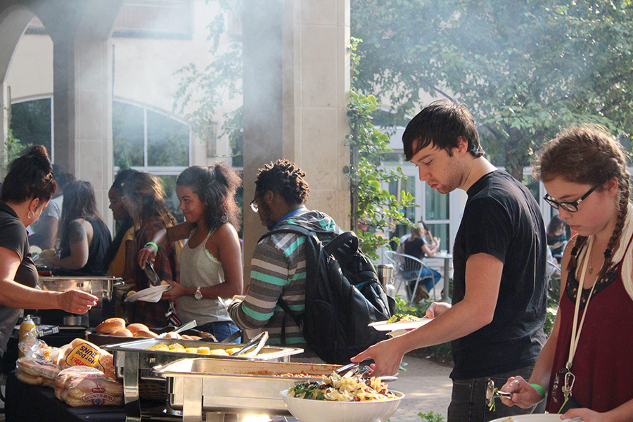 Students grab food at the Campus Activity Board's Pioneer Picnic on Monday. The picnic marks one of CAB's first events of the semester, highlighted by food and live music in Village Park.