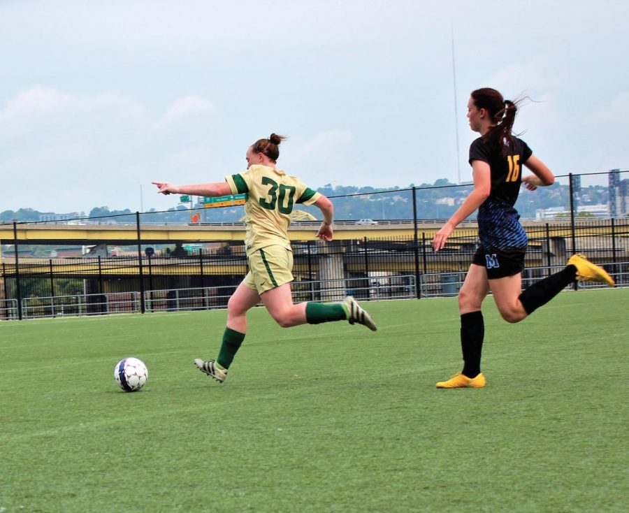 Doreen+Clark%2C+sophomore+midfielder%2C+leads+the+ball+towards+the+goal++in+Friday%E2%80%99s+match+against+Midway+University.+The+Pioneers+won+1-0.%0A