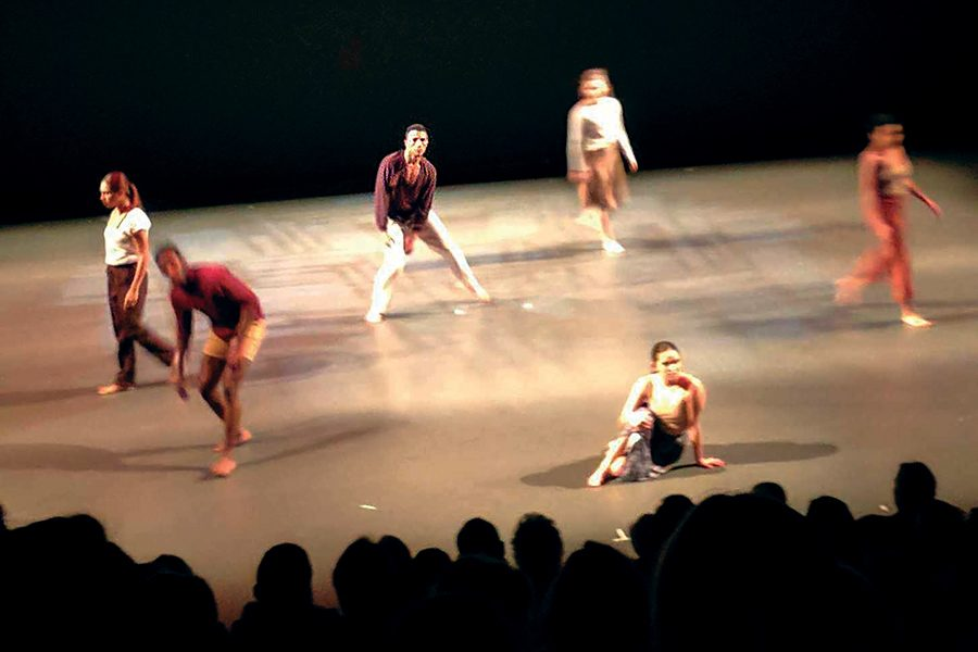 Dancers on stage performing in the Student Choreography Project at the Playhouse.