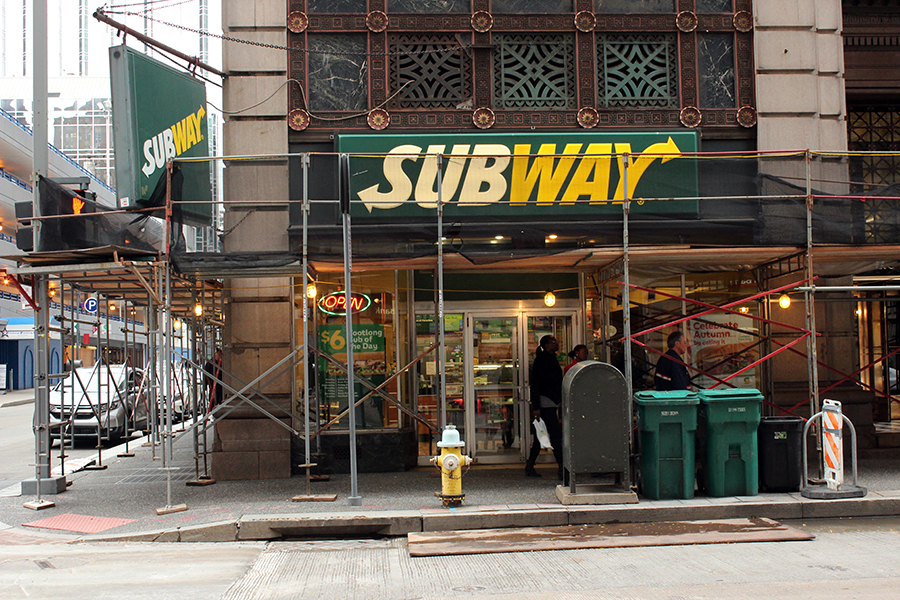 Scaffolding surrounds subway on the corner of Fourth Avenue and Wood Street. Subway is supposed to close in late December.