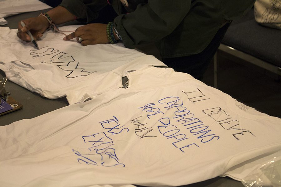 Silent protestors made t-shirts before the event and handed them out to anyone who wanted to participate in the protest.