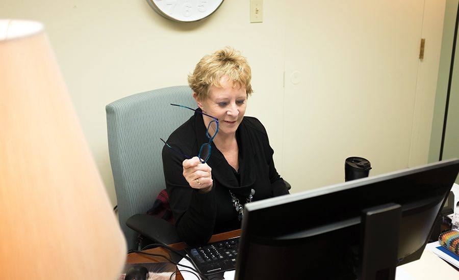 Taffie Bucci, Director of Counseling Services, working in her office on the 5th floor of Lawrence Hall.