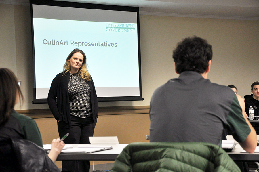 Terry Chavara, director of dining for CulinArt, listens to student concerns from Matt Bauman at Monday's USG meeting.