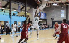 Road teams roll past men's basketball again