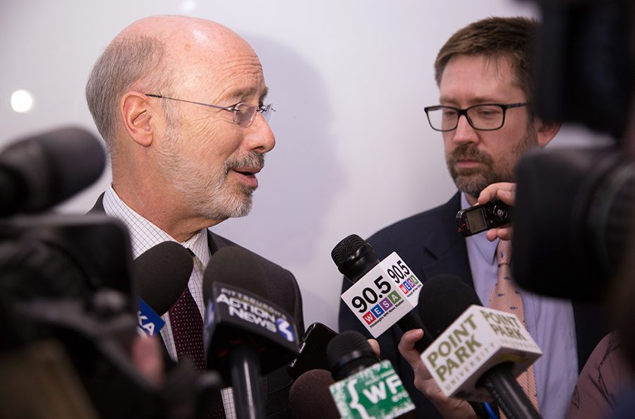 Pennsylvania Governor Tom Wolf talks with reporters at the Center for Media innovation last Thursday afternoon after publicly discussing the redrawing of PAs congressional map.