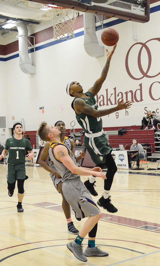Senior guard Rushan Roberts drives for a layup against Carlow last Tuesday. He recorded new career highs in points (26) and rebounds (11) in the loss.
