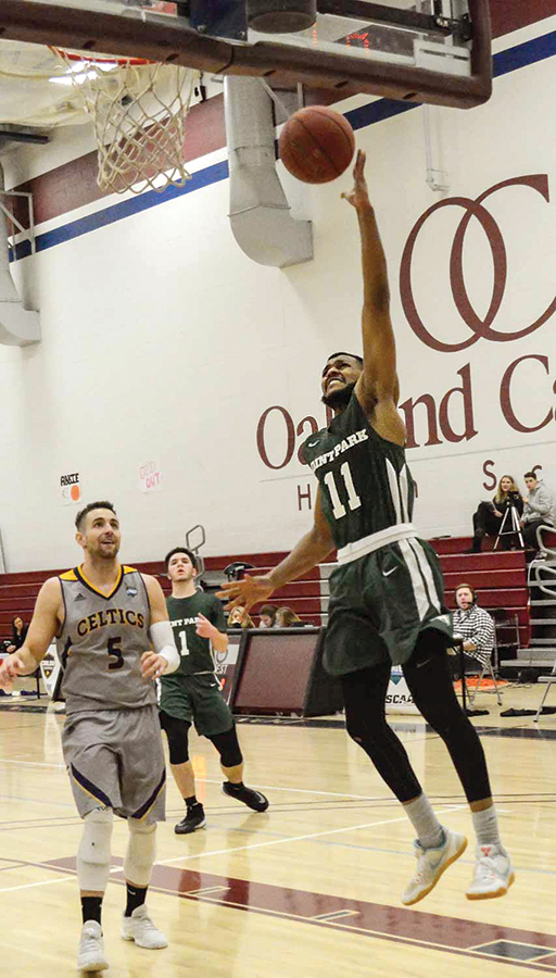 Senior guard Gavin Rajahpillay drives for a layup last week against Carlow. The Pioneers finished 4-22 after an 8-20 record last season.