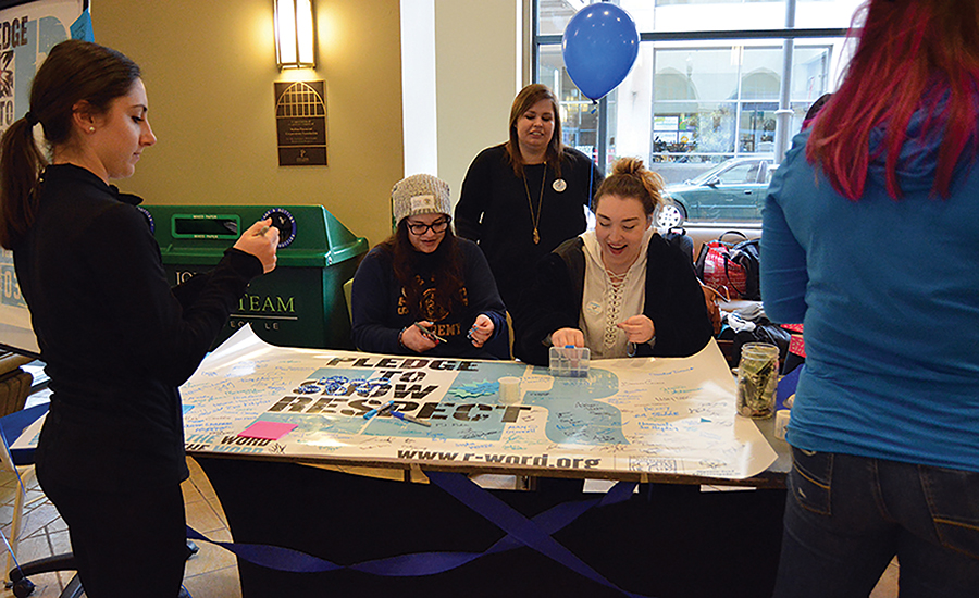 "The Education Department participated in a national ""Spread the Word to End the Word"" campaign Wednesday "" in the Lawrence Hall Lobby."
