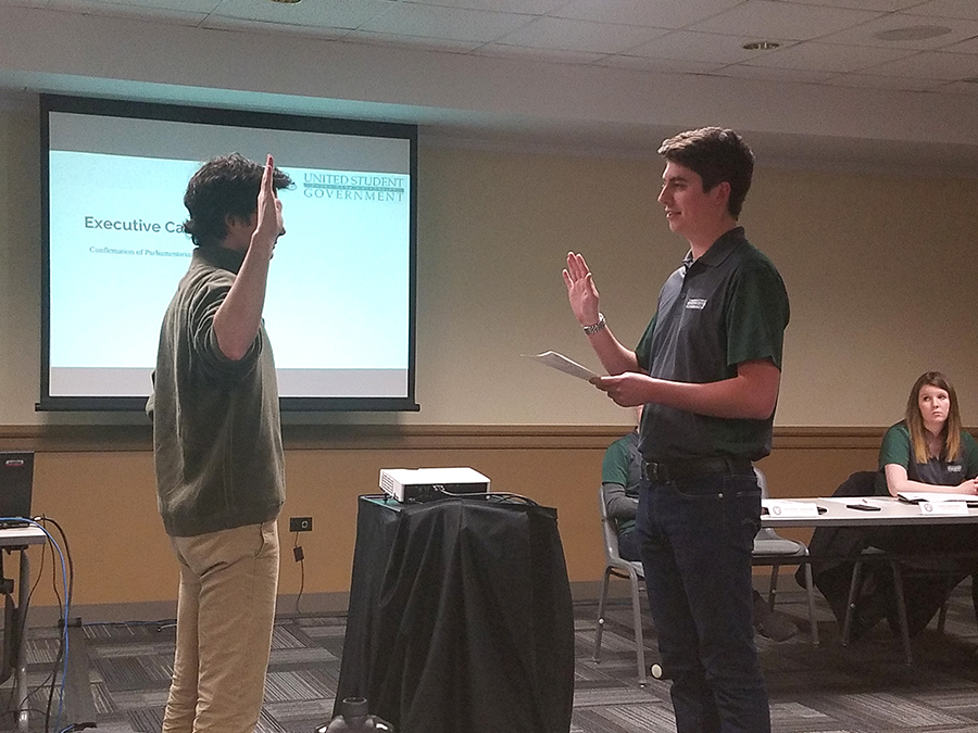 President Robert Bertha swears in Matt Bauman as parliamentarian in replacement of Zac Seymour.
