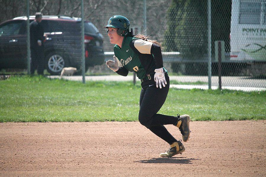 Senior+Kim+Corcoran+runs+to+second+base+in+a+game+last+season.+Corcoran+led+the+team+in+Florida+with+a+.400+batting+average+through+eight+games.+She+has+a+team-high+six+home+runs+last+season.