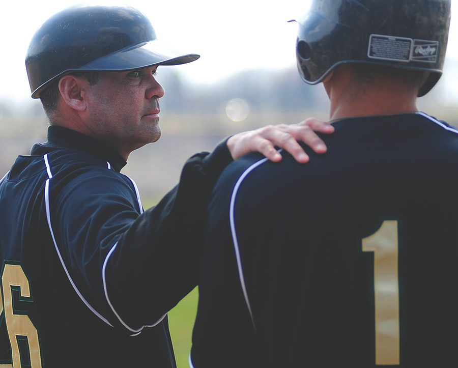 Head Coach Loren Torres talks with center fielder Brian Gise during his first season in 2010. Torres earned his 400th career win as a head coach last weekend and is on the verge of 300 wins with Point Park.