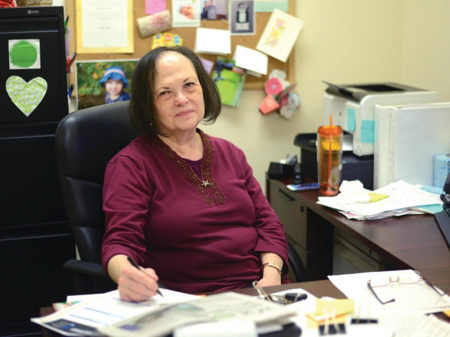 Career Development counselor Elsie Boucek sits at her desk on the fifth floor of West Penn.