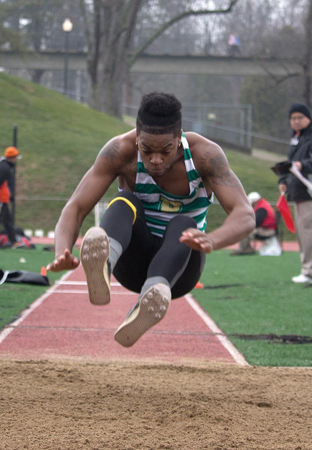 Junior Michael Morris jumps at a meet last season. Morris surpassed his high jump school record with a height measuring 1.99 meters last Saturday.