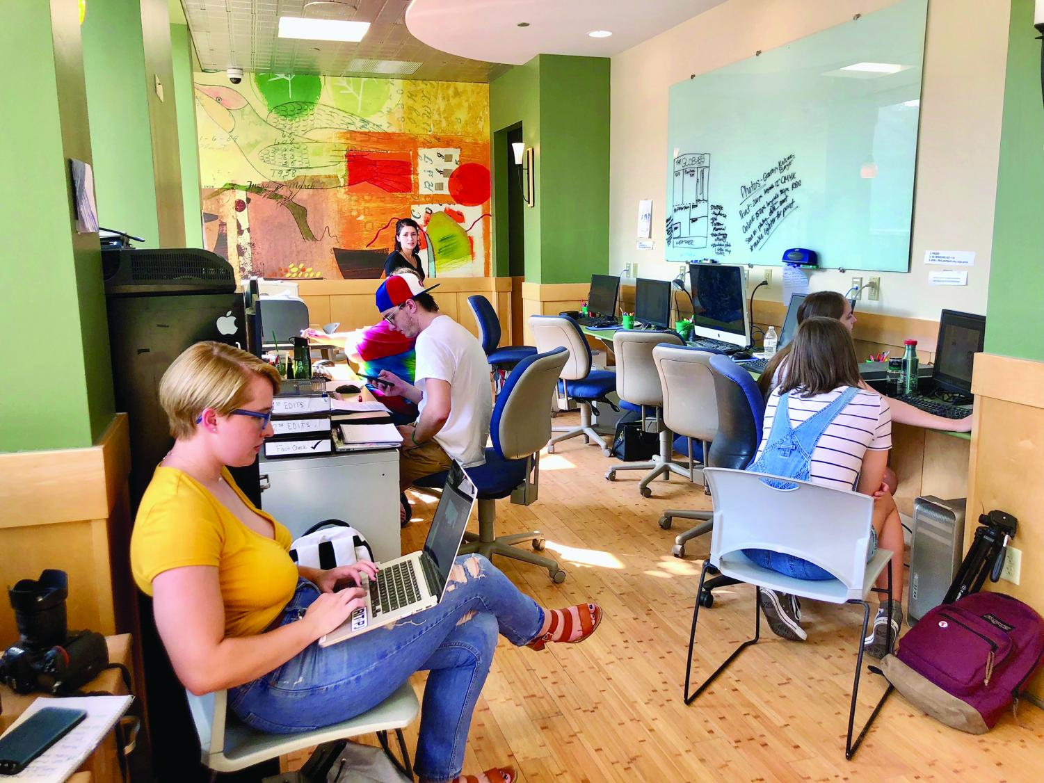 The Globe staff settles into its contemporary newsroom. The new offices, combined with the WPPJ studios, represent a new era for Point Park media.