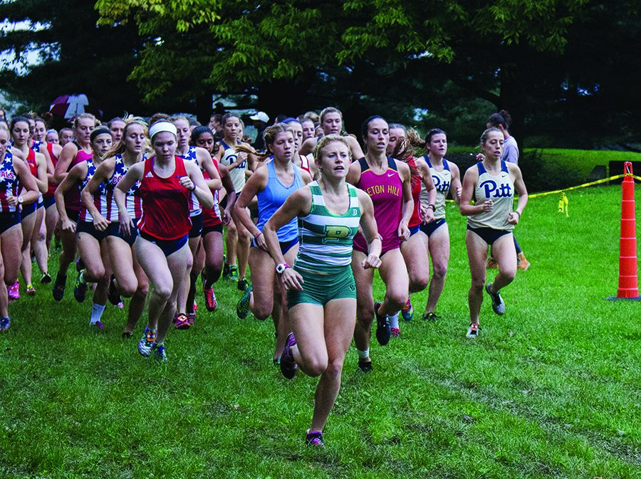 Senior Katie Guarnaccia leads the pack during the 2016 Carnegie Mellon University Invitational. Guarnaccia returns to the cross country and track and field teams after taking the 2017-2018 school year off.