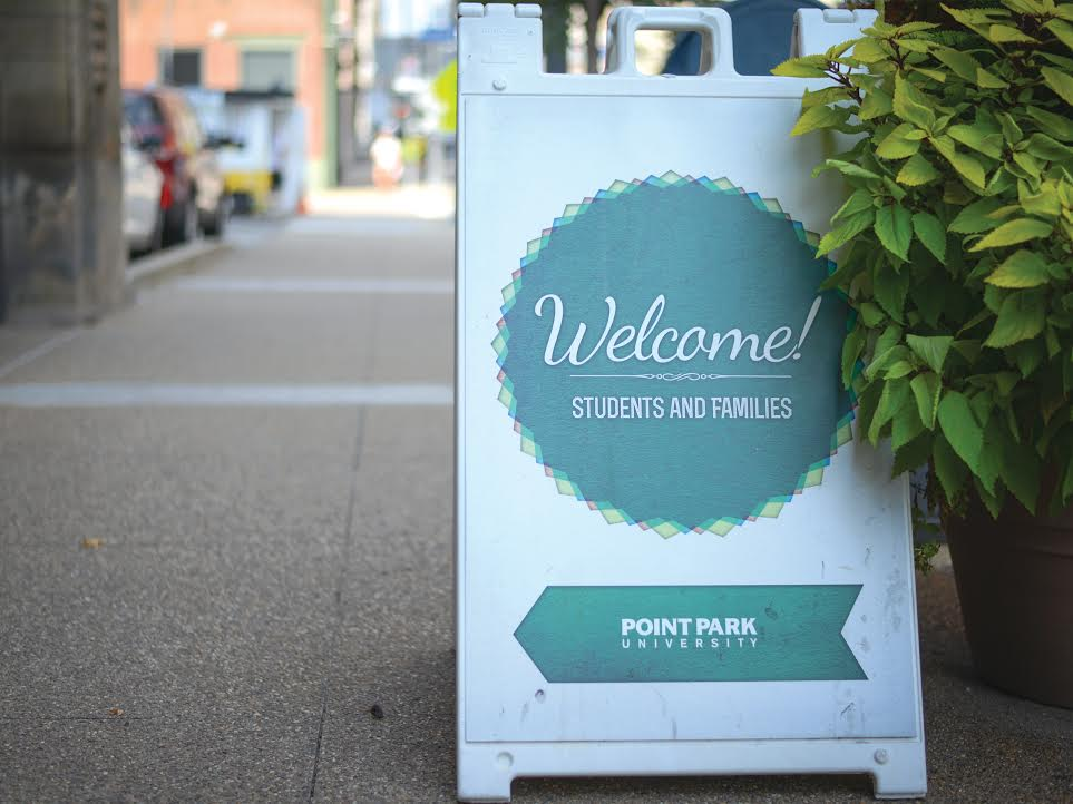A sign outside of Conestoga Hall welcomes Point Park Students back to campus for another semester.
