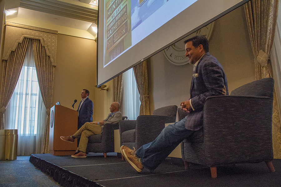 Chris Eames (Right) and  Sean Hanrahan (Middle) of  ESPN  and  Arby's President Rob Lynch (Left), address students during the first Pittsburgh Center for Sports Media and Marketing event of the semester.