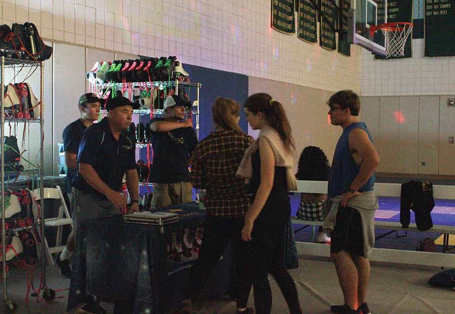 Students line up to trade their sneakers for skates at CAB's Roller Rink event  on Saturday night.